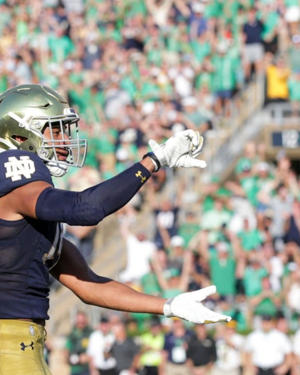 Notre Dame safety Kyle Hamilton (14) celebrates an interception during the fourth quarter of an NCAA football game, Saturday, Sept. 18, 2021 at Notre Dame Stadium in South Bend.
