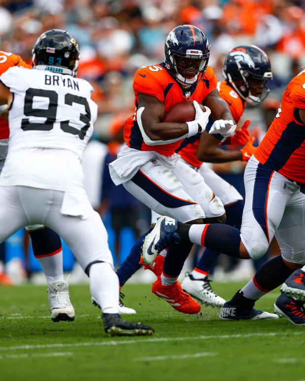 Denver Broncos running back Melvin Gordon (25) runs the ball against the Jacksonville Jaguars in the first quarter at TIAA Bank Field.