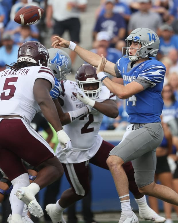 Memphis Tigers quarterback Seth Henigan throws the ball against the Mississippi State Bulldogs at Liberty Bowl Memorial Stadium on Saturday, Sept. 18, 2021.  Jrca5141