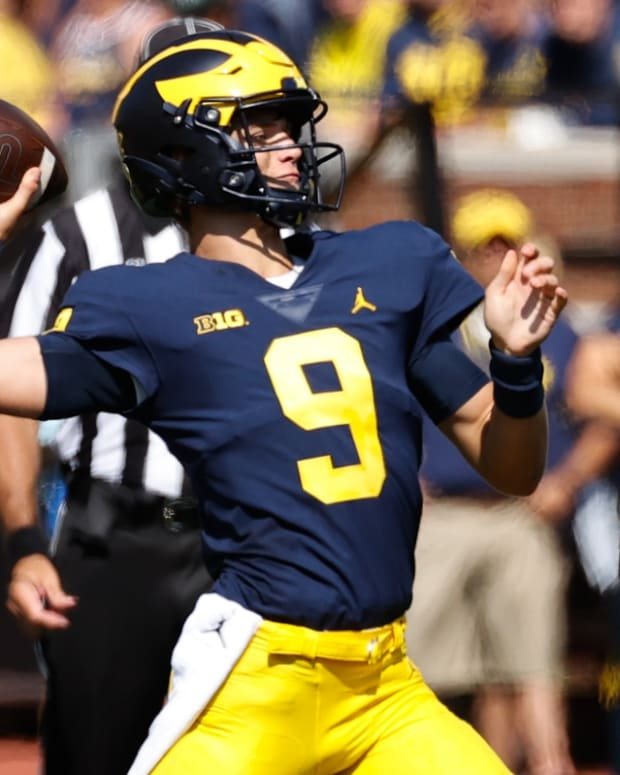 Sep 18, 2021; Ann Arbor, Michigan, USA; Michigan Wolverines quarterback J.J. McCarthy (9) passes in the second half against the Northern Illinois Huskies at Michigan Stadium. Mandatory Credit: Rick Osentoski-USA TODAY Sports