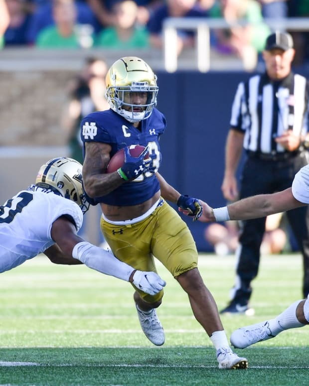 Sep 18, 2021; South Bend, Indiana, USA; Notre Dame Fighting Irish running back Kyren Williams (23) runs the ball on a punt return in the fourth quarter against the Purdue Boilermakers at Notre Dame Stadium. Mandatory Credit: Matt Cashore-USA TODAY Sports