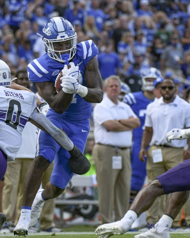 Sep 18, 2021; Durham, North Carolina, USA; Duke Blue Devils running back Jordan Waters (7) makes a cut to break a tackle by Northwestern Wildcats defensive back Coco Azema (0) during the second quarter at Wallace Wade Stadium. Mandatory Credit: William Howard-USA TODAY Sports