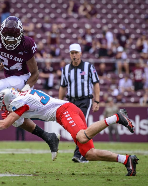 Sep 18, 2021; College Station, Texas, USA; New Mexico Lobos safety Mathias Bertram (31) and Texas A&M Aggies running back Earnest Crownover (24) in action during the game between the Texas A&M Aggies and the New Mexico Lobos at Kyle Field. Mandatory Credit: Jerome Miron-USA TODAY Sports