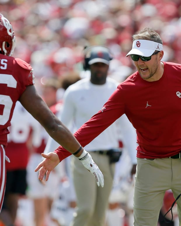 Oklahoma coach Lincoln Riley slaps hands with Oklahoma's Kennedy Brooks (26) during a college football game between the University of Oklahoma Sooners (OU) and the Nebraska Cornhuskers at Gaylord Family-Oklahoma Memorial Stadium in Norman, Okla., Saturday, Sept. 18, 2021. Oklahoma won 23-16.