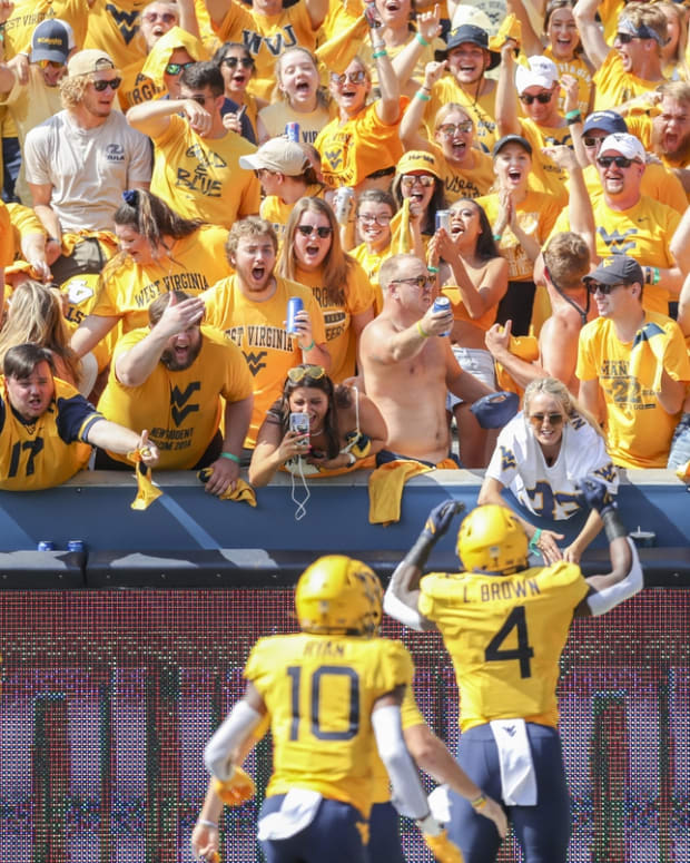 Sep 18, 2021; Morgantown, West Virginia, USA; West Virginia Mountaineers students celebrate after a touchdown from West Virginia Mountaineers running back Leddie Brown (4) during the first quarter against the Virginia Tech Hokies at Mountaineer Field at Milan Puskar Stadium. Mandatory Credit: Ben Queen-USA TODAY Sports