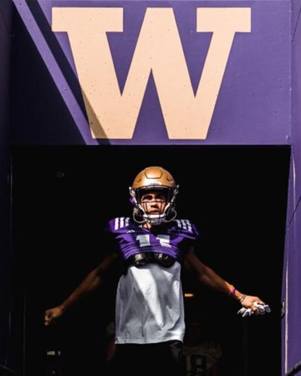 Jalen McMillen emerges from the Husky Stadium tunnel.