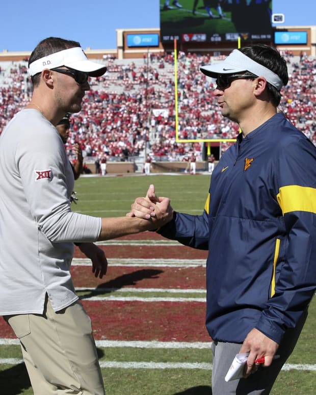 Oct 19, 2019; Norman, OK, USA; Oklahoma Sooners head coach Lincoln Riley (left) greets West Virginia Mountaineers head coach Neal Brown after the game at Gaylord Family - Oklahoma Memorial Stadium.