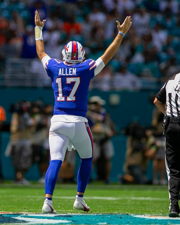 Buffalo Bills Buffalo Bills quarterback Josh Allen (17), cheers the first touchdown agains the Dolphins during NFL game at Hard Rock Stadium Sunday in Miami Gardens.  Dolphins V Bills 19