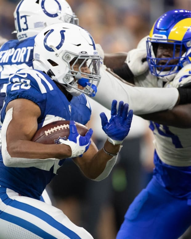Sep 19, 2021; Indianapolis, Indiana, USA; Indianapolis Colts running back Jonathan Taylor (28) runs the ball in the second half against the Los Angeles Rams at Lucas Oil Stadium. Mandatory Credit: Trevor Ruszkowski-USA TODAY Sports