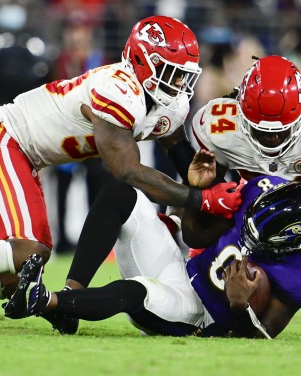 Sep 19, 2021; Baltimore, Maryland, USA; Baltimore Ravens quarterback Lamar Jackson (8) is tackled by Kansas City Chiefs safety Armani Watts (23) and inebacker Nick Bolton (54) during the fourth quarter at M&T Bank Stadium. Mandatory Credit: Tommy Gilligan-USA TODAY Sports