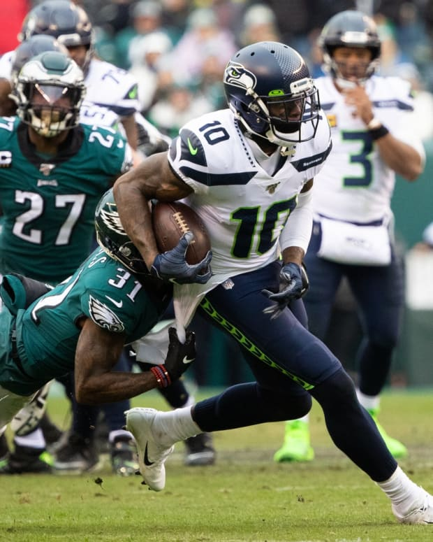 Nov 24, 2019; Philadelphia, PA, USA; Seattle Seahawks wide receiver Josh Gordon (10) catches the ball and is tackled by Philadelphia Eagles cornerback Jalen Mills (31) during the second quarter at Lincoln Financial Field. Mandatory Credit: Bill Streicher-USA TODAY Sports
