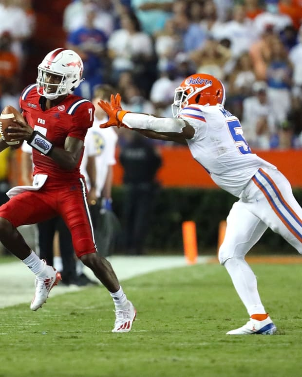 Florida Atlantic Owls quarterback N'Kosi Perry (7) is run out of bounds by Florida Gators linebacker Ventrell Miller (51) during a game against the Florida Atlantic Owls at Ben Hill Griffin Stadium in Gainesville Fla. Sept. 4, 2021.  UFfauGameAction30