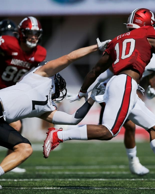 Cincinnati Bearcats linebacker Wilson Huber (2) is unable to pulldown Indiana Hoosiers running back David Ellis (10) on a carry in the first quarter of the NCAA football game between the Indiana Hoosiers and the Cincinnati Bearcats at Memorial Stadium in Bloomington, Ind., on Saturday, Sept. 18, 2021.  Cincinnati Bearcats At Indiana Hoosiers Football