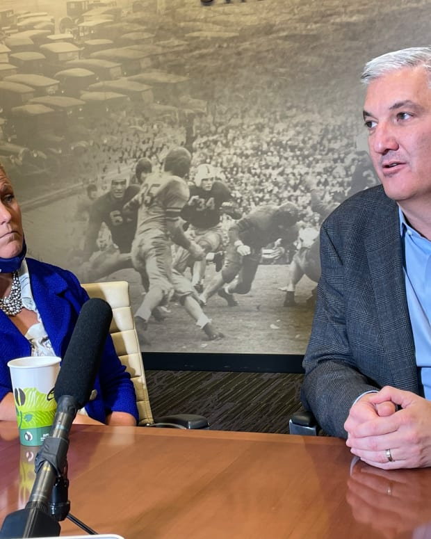 Pac-12 commissioner George Kliavkoff sits with UW athletic director Jen Cohen.