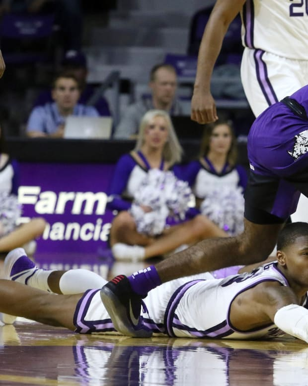 P.J. Fuller steals the ball from a Kansas State opponent.