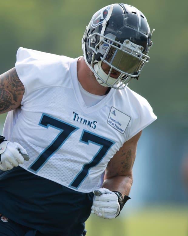 Tennessee Titans tackle Taylor Lewan (77) runs through blocking drills during a training camp practice at Saint Thomas Sports Park Thursday, July 29, 2021 in Nashville, Tenn.