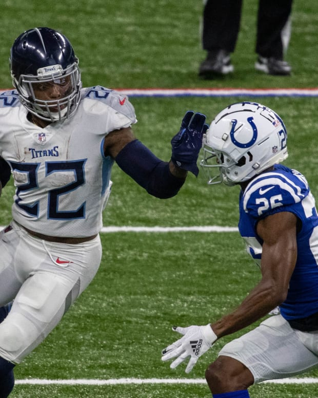 Nov 29, 2020; Indianapolis, Indiana, USA; Tennessee Titans running back Derrick Henry (22) runs the ball while Indianapolis Colts cornerback Rock Ya-Sin (26) defends in the second half at Lucas Oil Stadium. Mandatory Credit: Trevor Ruszkowski-USA TODAY Sports