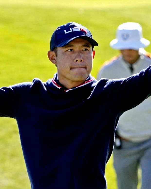 Collin Morikawa celebrates the American's eagle on the sixth hole