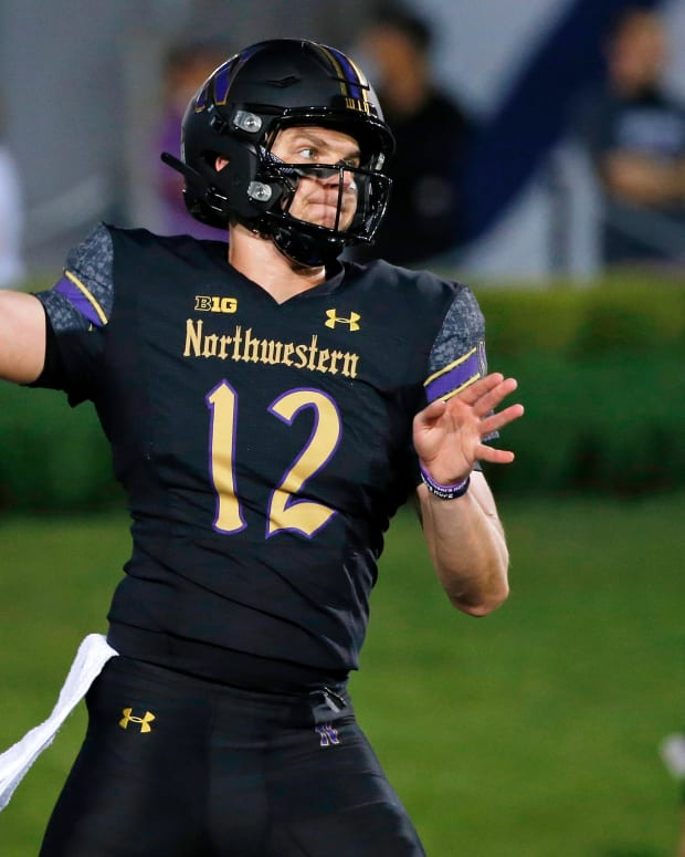 Sep 3, 2021; Evanston, Illinois, USA; Northwestern Wildcats quarterback Ryan Hilinski (12) passes the ball during warmups before the game against the Michigan State Spartans at Ryan Field. Mandatory Credit: Jon Durr-USA TODAY Sports