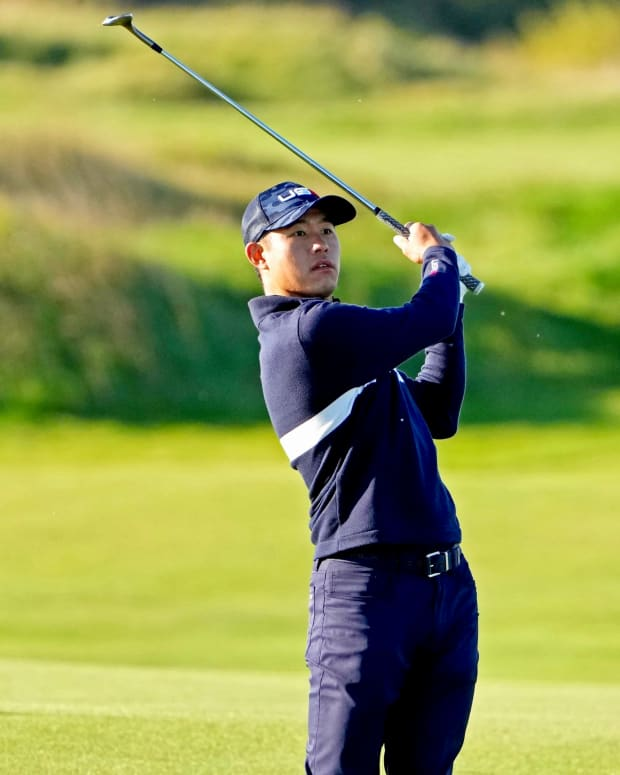 Collin Morikawa watches his iron shot on Day 2 of the Ryder Cup