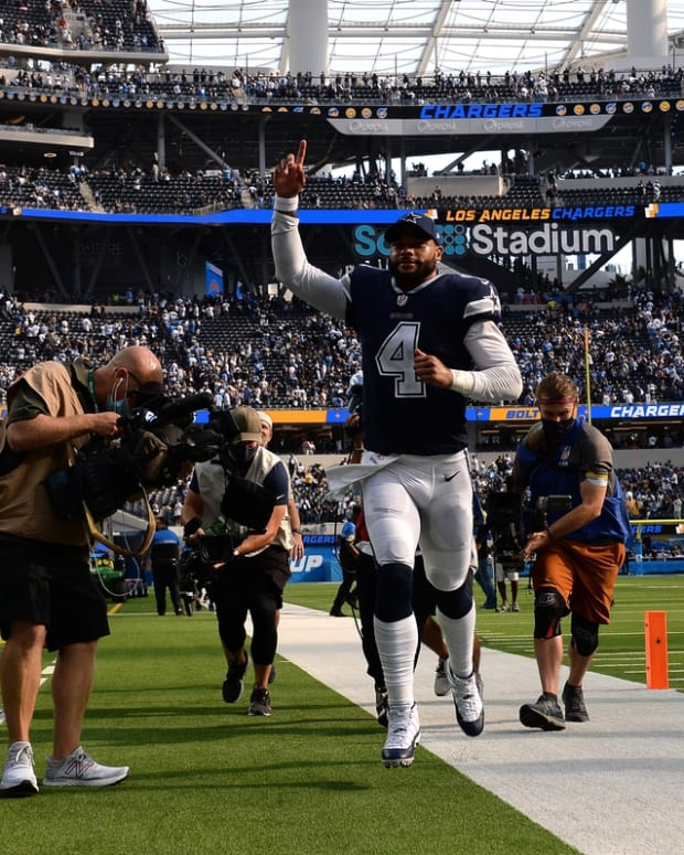Sep 19, 2021; Inglewood, California, USA; Dallas Cowboys quarterback Dak Prescott (4) gestures as he runs off the field after defeating the Los Angeles Chargers at SoFi Stadium. Mandatory Credit: Orlando Ramirez-USA TODAY Sports