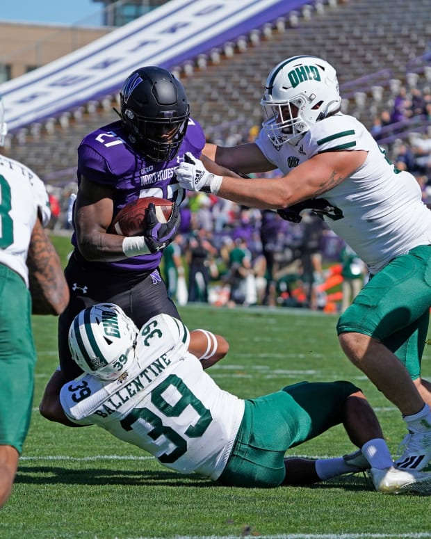 Sep 25, 2021; Evanston, Illinois, USA; Northwestern Wildcats running back Anthony Tyus III (27) runs the ball as Ohio Bobcats safety Michael Ballentine (39) tackles him during the first half at Ryan Field. Mandatory Credit: David Banks-USA TODAY Sports