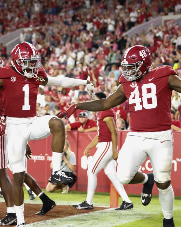 Jameson Williams celebrates with teammates