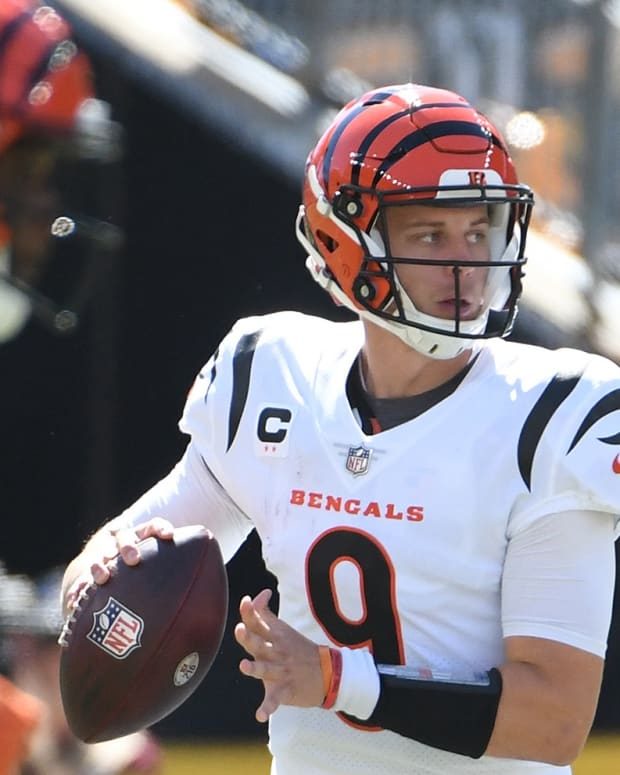 Sep 19, 2021; Pittsburgh, Pennsylvania, USA; Cincinnati Bengals quarterback Joe Burrow looks for a receiver against the Pittsburgh Steelers during the first quarter at Heinz Field. Mandatory Credit: Philip G. Pavely-USA TODAY Sports