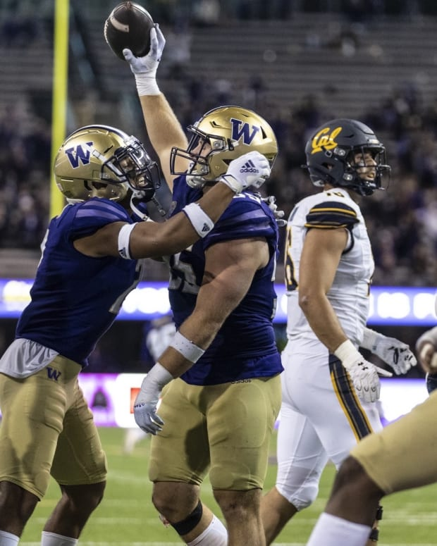 Kyler Gordon celebrates with Ryan Bowman after game-ending fumble recovery against Cal.