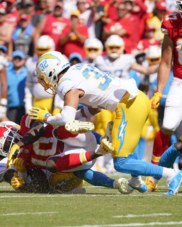 Sep 26, 2021; Kansas City, Missouri, USA; Los Angeles Chargers cornerback Michael Davis (43) recovers a fumble from Kansas City Chiefs wide receiver Tyreek Hill (10) during the first half at GEHA Field at Arrowhead Stadium. Mandatory Credit: Denny Medley-USA TODAY Sports