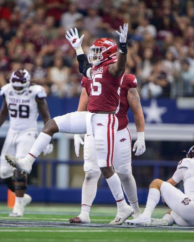 Sep 25, 2021; Arlington, Texas, USA; Arkansas Razorbacks defensive lineman Tre Williams (55) celebrates a sack of Texas A&M Aggies quarterback Zach Calzada (10) during the second quarter at AT&T Stadium.