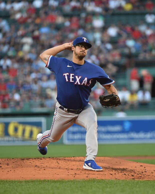 Aug 20, 2021; Boston, Massachusetts, USA; Texas Rangers starting pitcher Dane Dunning (33) pitches during the first inning against the Boston Red Sox at Fenway Park. Mandatory Credit: Bob DeChiara-USA TODAY Sports