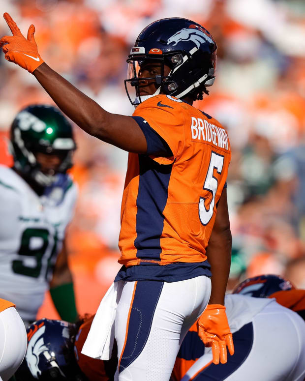 Denver Broncos quarterback Teddy Bridgewater (5) gestures at the line of scrimmage in the fourth quarter against the New York Jets at Empower Field at Mile High.