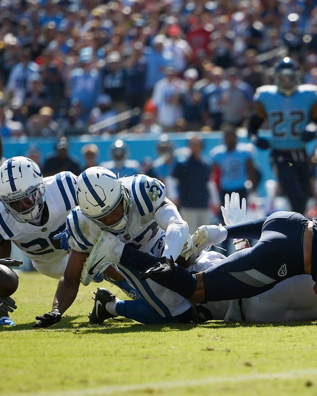 Sep 26, 2021; Nashville, Tennessee, USA; Indianapolis Colts safety Julian Blackmon (32), cornerback Rock Ya-Sin (26) and outside linebacker Darius Leonard (53) dive for the loose ball against the Tennessee Titans during the second half at Nissan Stadium. Mandatory Credit: Steve Roberts-USA TODAY Sports