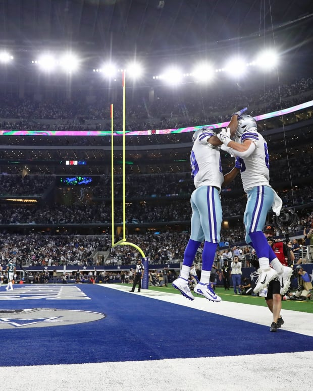 Cowboys celebrate one of their three firsth-half touchdowns against the Eagles