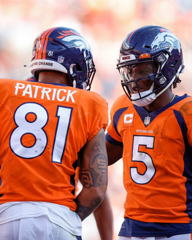 Denver Broncos quarterback Teddy Bridgewater (5) with wide receiver Tim Patrick (81) in the fourth quarter against the New York Jets at Empower Field at Mile High.
