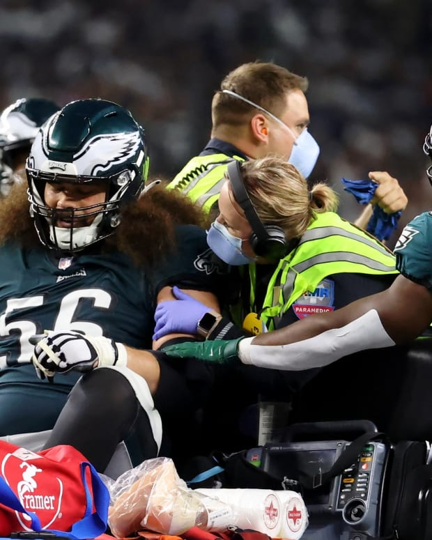 Isaac Seumalo gets carted off the field in the fourth quarter of the Eagles' loss to the Cowboys on Sept. 27, 2021