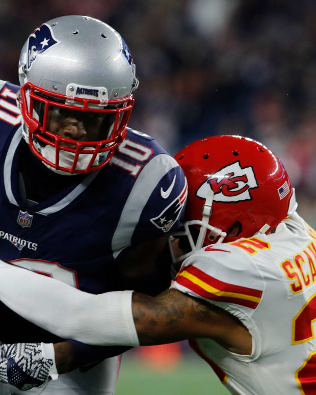 Oct 14, 2018; Foxborough, MA, USA; New England Patriots wide receiver Josh Gordon (10) runs after a catch against Kansas City Chiefs defensive back Orlando Scandrick (22) in the second half at Gillette Stadium. The Patriots defeated Kansas City 43-40. Mandatory Credit: David Butler II-USA TODAY Sports