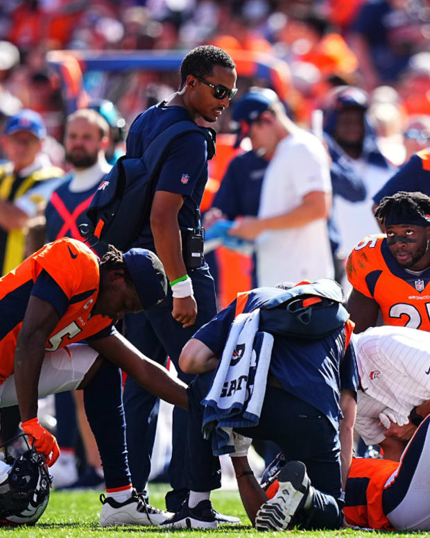 Sep 26, 2021; Denver, Colorado, USA; Denver Broncos wide receiver K.J. Hamler (1) is treated for an injury as quarterback Teddy Bridgewater (5) and running back Melvin Gordon (25) and head coach Vic Fangio observe in the second quarter against the New York Jets at Empower Field at Mile High.