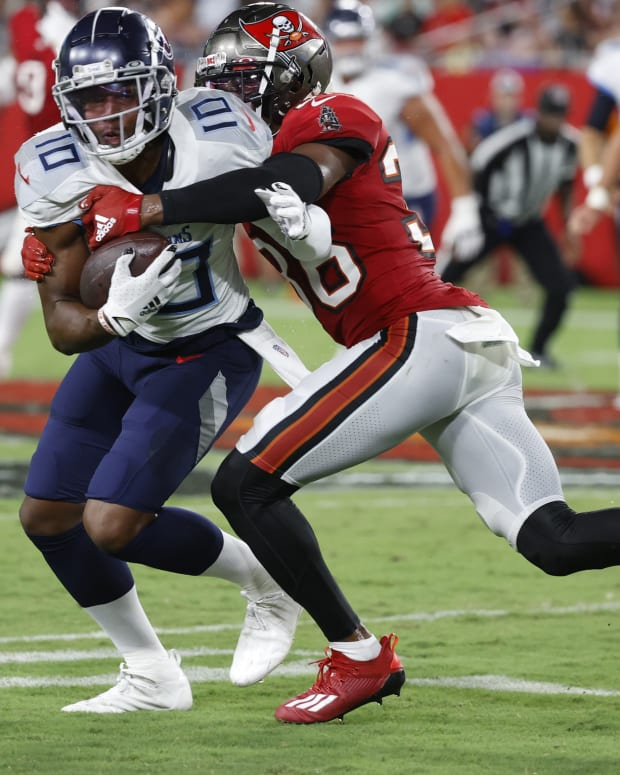 Aug 21, 2021; Tampa, Florida, USA; Tennessee Titans wide receiver Dez Fitzpatrick (10) runs the ball against Tampa Bay Buccaneers cornerback Herb Miller (36) tackles during the second quarter at Raymond James Stadium. Mandatory Credit: Kim Klement-USA TODAY Sports