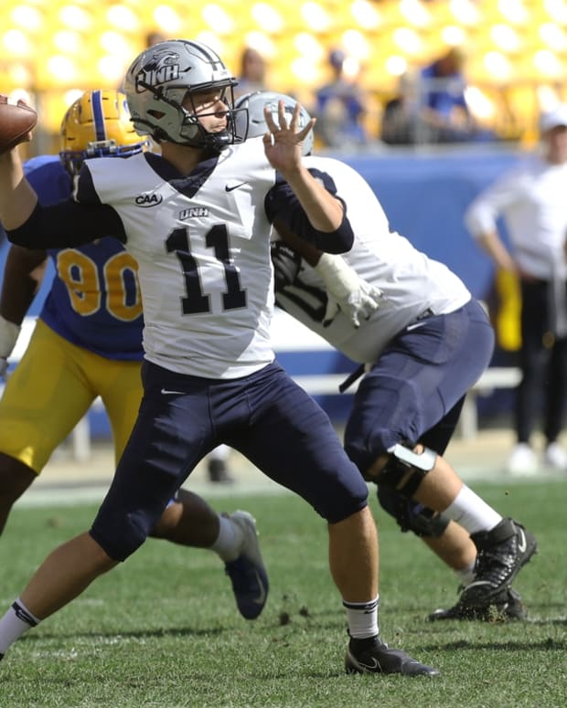 Sep 25, 2021; Pittsburgh, Pennsylvania, USA; New Hampshire Wildcats quarterback Tommy Herion (11) passes the ball against the Pittsburgh Panthers during the fourth quarter at Heinz Field. Pittsburgh won 77-7. Mandatory Credit: Charles LeClaire-USA TODAY Sports