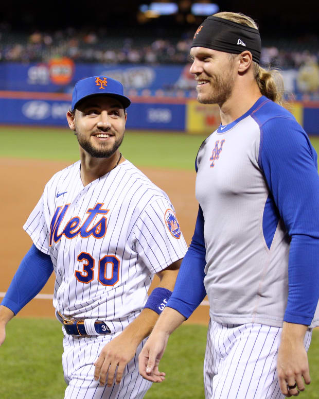 Sep 29, 2021; New York City, New York, USA; New York Mets right fielder Michael Conforto (30) and starting pitcher Noah Syndergaard (34) walk to the dugout before a game against the Miami Marlins at Citi Field.