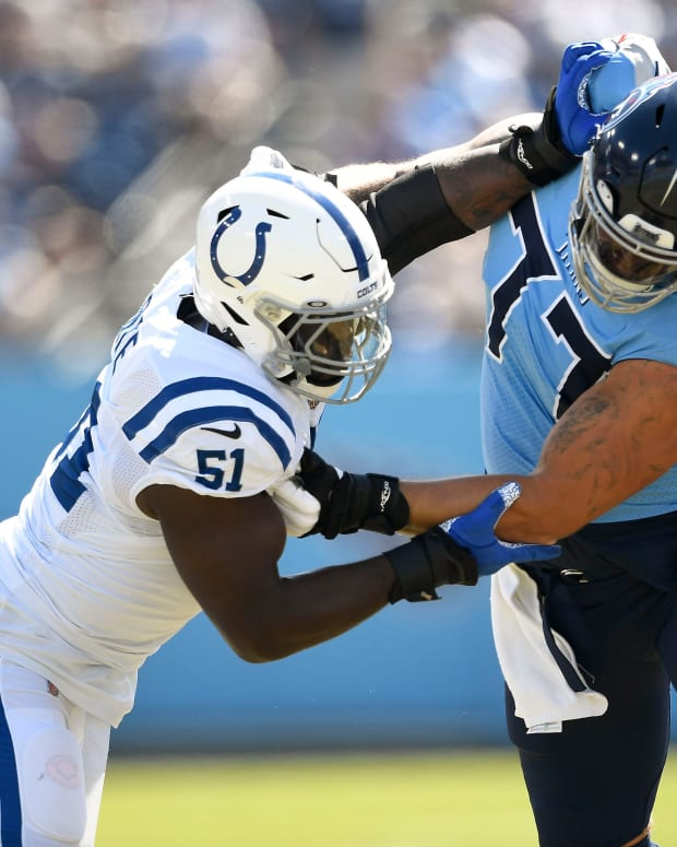 Tennessee Titans offensive tackle Taylor Lewan (77) blocks Indianapolis Colts defensive end Kwity Paye (51) during the first quarter at Nissan Stadium Sunday, Sept. 26, 2021 in Nashville, Tenn. Titans Colts 089