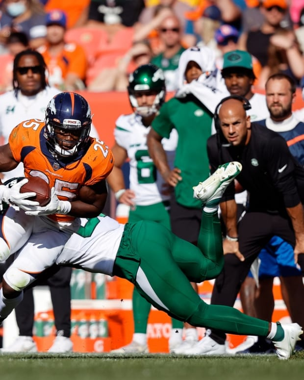 Sep 26, 2021; Denver, Colorado, USA; Denver Broncos running back Melvin Gordon III (25) avoids the tackle of New York Jets outside linebacker Quincy Williams (56) in the third quarter at Empower Field at Mile High. Mandatory Credit: Isaiah J. Downing-USA TODAY Sports
