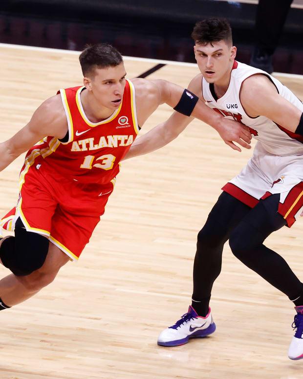 Miami Heat guard Tyler Herro (14) defends Atlanta Hawks guard Bogdan Bogdanovic (13) during the first half at American Airlines Arena.