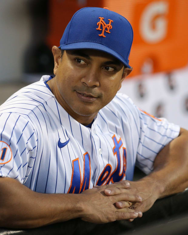 Sep 18, 2021; New York City, New York, USA; New York Mets manager Luis Rojas (19) looks on from the dugout before a game against the Philadelphia Phillies at Citi Field.