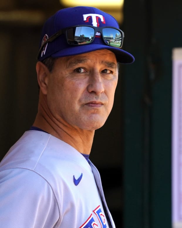 Sep 11, 2021; Oakland, California, USA; Texas Rangers bench coach Don Wakamatsu (22) stands in the dugout before the game against the Oakland Athletics at RingCentral Coliseum. Mandatory Credit: Darren Yamashita-USA TODAY Sports