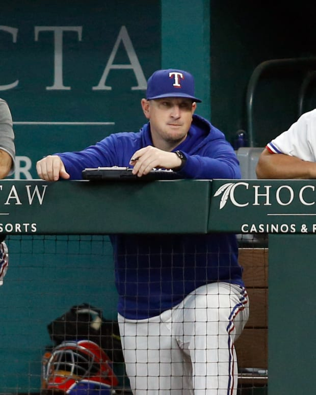 Aug 5, 2021; Arlington, Texas, USA; Texas Rangers manager Chris Woodward (8) and pitching coach Doug Mathis (71) and bench coach Don Wakamatsu (22) watch play in the first inning against the Los Angeles Angels at Globe Life Field. Mandatory Credit: Tim Heitman-USA TODAY Sports
