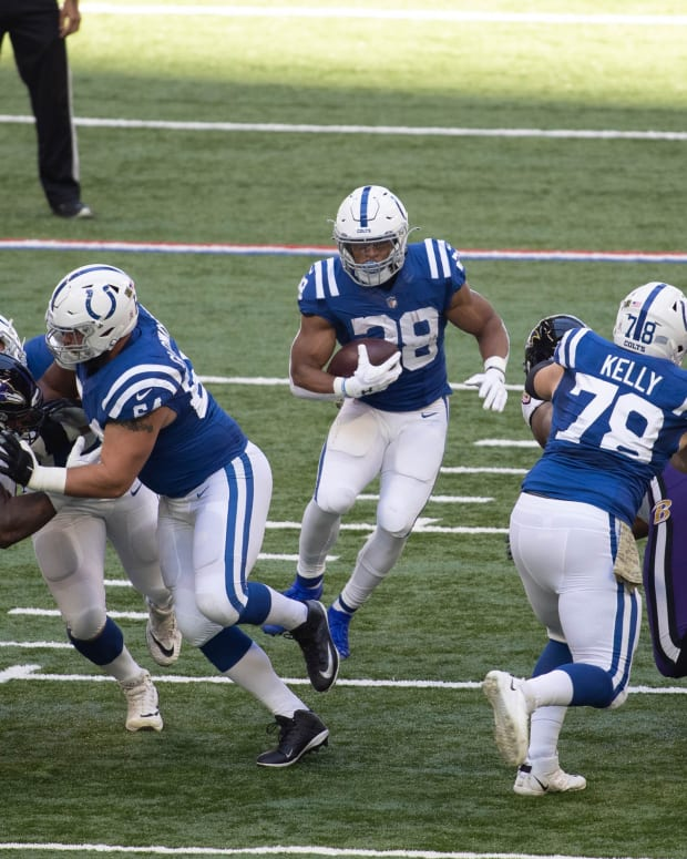 Nov 8, 2020; Indianapolis, Indiana, USA; Indianapolis Colts running back Jonathan Taylor (28) runs the ball against the Baltimore Ravens in the first half at Lucas Oil Stadium.