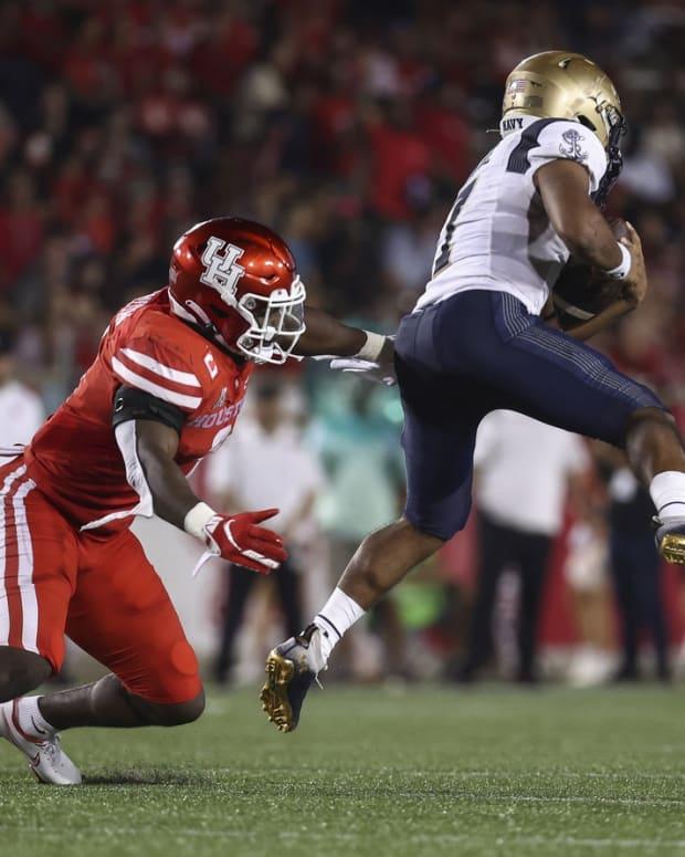 Sep 25, 2021; Houston, Texas, USA; Houston Cougars linebacker Donavan Mutin (3) attempts to tackle Navy Midshipmen quarterback Xavier Arline (7) during the third quarter at TDECU Stadium. Mandatory Credit: Troy Taormina-USA TODAY Sports